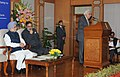 Kapil Sibal addressing at the golden jubilee ceremony of IIFT, in New Delhi on December 21, 2013. The Prime Minister, Dr. Manmohan Singh and the Union Minister for Commerce & Industry, Shri Anand Sharma are also seen.jpg