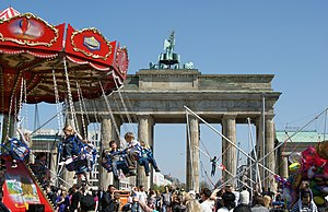 Demographics of Berlin - Children in a theme park in front of the Brandenburg Gate