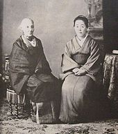 Black-and-white photo of two seated women