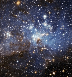 Intergalactic travel - Stars in the Large Magellanic Cloud, a dwarf galaxy. At a distance of 163,000 light-years, the LMC is the third closest galaxy to the Milky Way.