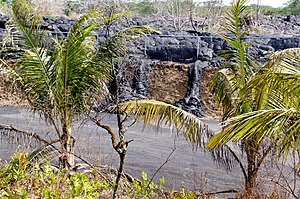 Puʻu ʻŌʻō - Lava from the Puʻu ʻŌʻō cinder cone has flowed 14 miles into the town of Pāhoa. The lava has breached the boundary of the Pāhoa Transfer Station.