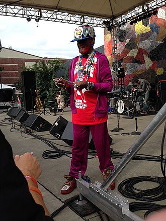 "Lee ""Scratch"" Perry - Perry signing an autograph after a performance at Bumbershoot in 2015."