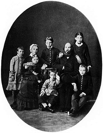 Aleksandr Ulyanov - The Ulyanov family, 1879 (Aleksandr standing in the middle, Vladimir sitting to the right)