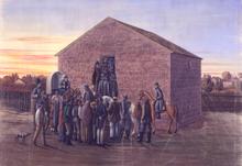 Gli uomini vengono trascinati in un piccolo edificio di mattoni