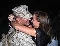 Lieutenant Palm is greeted by his wife during a homecoming event after deployment supporting operation Enduring Freedom.jpg
