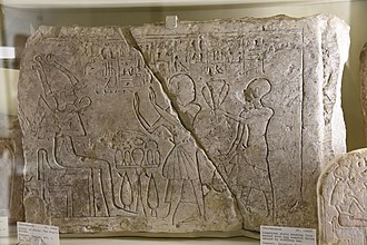 Sopdu - Lintel of Raiay, the King's scribe, and the first god's servant of Sopdu Nakht. Both stand before Osiris. 19th Dynasty. From Egypt. The Petrie Museum of Egyptian Archaeology, London
