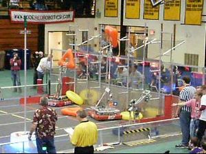 Logo Motion - Teams 3357 and 857 scoring tubes at the Traverse City district.