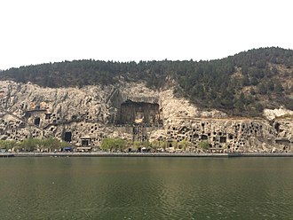 Longmen Grottoes - View of the West Hill Grottoes from the east bank of the Yi River.