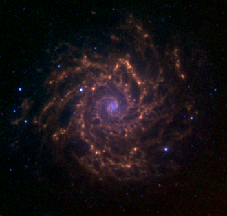 Messier 74 - M74 as observed with the Spitzer Space Telescope as part of the Spitzer Infrared Nearby Galaxy Survey. The blue colors represent the 3.6 micrometre emission from stars. The green and red colors represent the 5.8 and 8.0 micrometre emission from polycyclic aromatic hydrocarbons and possibly dust.