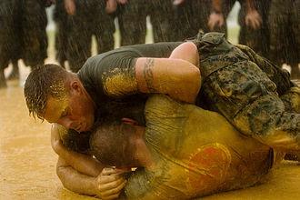 Marine Corps Martial Arts Program - Marines practice ground fighting in the rain.