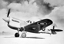Single-engined military monoplane on desert airfield