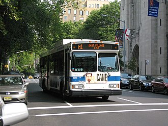 Fifth and Madison Avenues Line - An M1 bus traveling south along Fifth Avenue near Central Park.