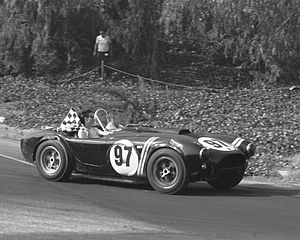Dave MacDonald - Dave MacDonald takes wife Sherry on victory lap in Shelby Cobra CSX2128. Pomona July 1963.