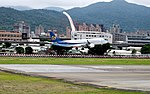 Mandarin Airlines Embraer ERJ 190 B-16825 on Final Approach at Taipei Songshan Airport 20150321c.jpg