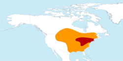 Distribution map, with normal range in orange and breeding zone in red