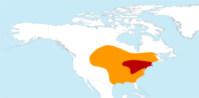 Distribution map, with breeding zone in red and wintering zone in orange