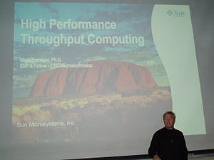 Marc Tremblay - Marc Tremblay giving a talk on high performance throughput computing.
