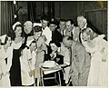 "Maree Austin, US star John Hubbard and cast of ""Mary had a little"" celebrate a birthday, Tivoli Theatre, Melbourne, 1951 - Harry Jay (6597392833).jpg"