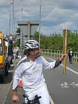 Mark Beaumont carrying the olympic torch - 01.jpg