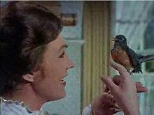 Mary Poppins, mentre canta Basta un poco di zucchero, duettando con un pettirosso