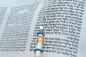 Book of Esther - The opening chapter of a hand-written scroll of the Book of Esther, with reader's pointer