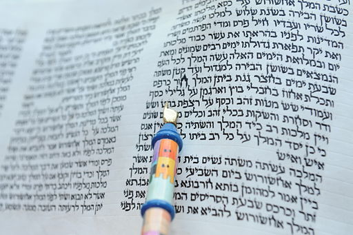 First chapter of a hand-written scroll of the Book of Esther, with reader's pointer