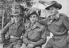 Three men posing for a photograph wearing British Army uniform