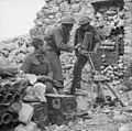 Men of the 6th Battalion, Royal West Kent Regiment man a 3-inch mortar on Monastery Hill, Cassino, Italy, 26 March 1944. NA13365.jpg