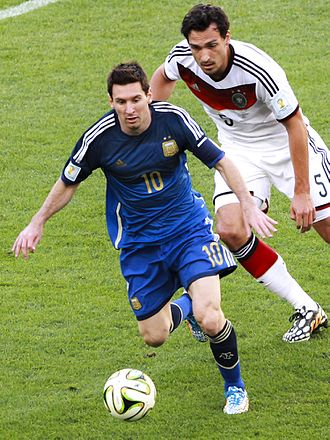 2014 FIFA World Cup Final - Argentina's Lionel Messi (front) battles Germany's Mats Hummels for the ball.