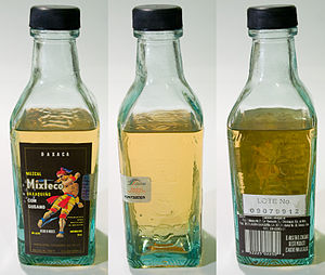 Mezcal - Various views of a bottle of mezcal. The worm can be seen in the middle image, at the bottom of the bottle.