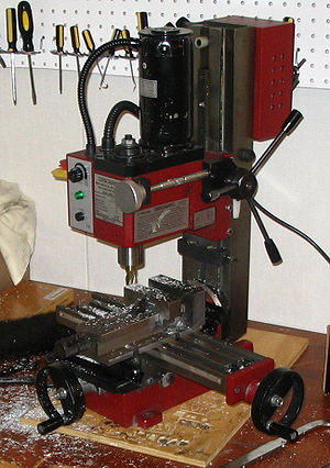 Milling (machining) - A Sieg X2 miniature hobbyist mill plainly showing the basic parts of a mill.