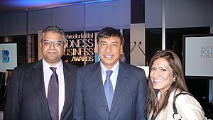in the middle Lakshmi Mittal, CEO & Chairman o...