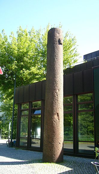 Bavarian State Archaeological Collection - A sandstone monolith dated to the 11th century at the entrance of the Bavarian State Archaeological Collection.