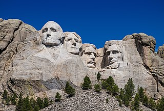Mount Rushmore Mountain in South Dakota featuring a sculpture of four US presidents
