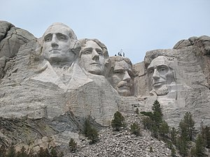 English: Mount Rushmore with several workers o...