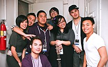Photograph of Filipino American musicians - six men and two women