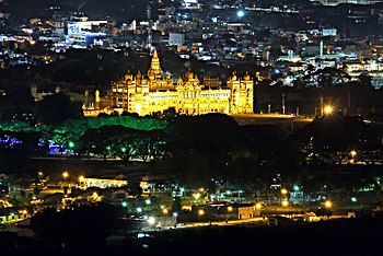 Mysore Palace seen from Chamundi Hill Viewpoint at night.jpg