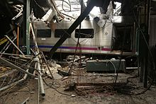 The cab car surrounded by the destroyed canopy