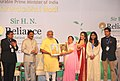 Narendra Modi being presented a memento by Mrs. Kokilaben Dhirubhai Ambani at the ceremony held to rededicate Sir H.N. Reliance Foundation Hospital and Research Centre, in Mumbai. The Governor of Maharashtra.jpg