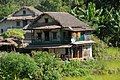 Nepali house in the Himalayas, Autonomous electricity, satellite TV and a thatched roof. - panoramio.jpg