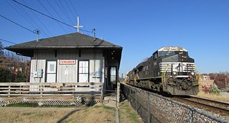 Ferguson, Missouri - A train rolls past the former Wabash station (now an ice cream parlor) in Ferguson.