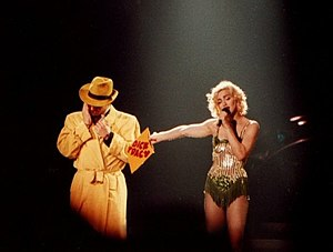 "Dick Tracy (1990 film) - Madonna's 1990 Blond Ambition World Tour was seen as a way of promotion for the film. Here she is seen performing ""Now I'm Following You"", from her I'm Breathless album, with a Dick Tracy lookalike."