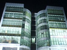 Glass-block office building at night