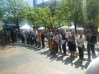 Oath of Allegiance (United States) - 15 people from ten countries taking and subscribing to the Oath of Allegiance on World Refugee Day in Boise, Idaho, in 2015.