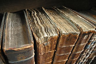 Preservation (library and archival science) - Worn books at the library of Merton College, Oxford.