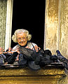 Old woman feeding birds clipped.jpg