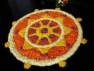 Onam - Flower arrangements, called pookalam, are a famous Onam tradition.