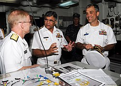 Pakistani Navy Chief of Naval Staff Adm. M. Asif Sandila, center, U.S. Navy Rear Adm. Daryl Caudle, left, and U.S. Navy Capt. Andrew J. Loiselle, the commanding officer of the aircraft carrier USS George H.W 130918-N-MU440-014.jpg