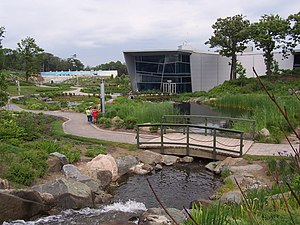 Aquarium du Québec - The main building, the stream and part of the garden.