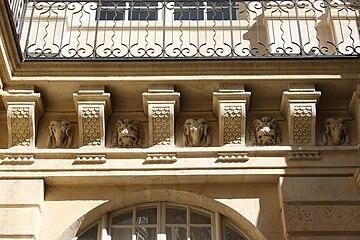 Mascarons On The Courtyard Balcony Frise